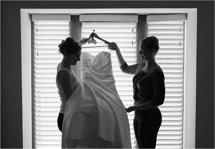 Kingscote Barn hanging the wedding dress photo