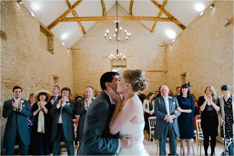 Kingscote Barn kissing the bride photo