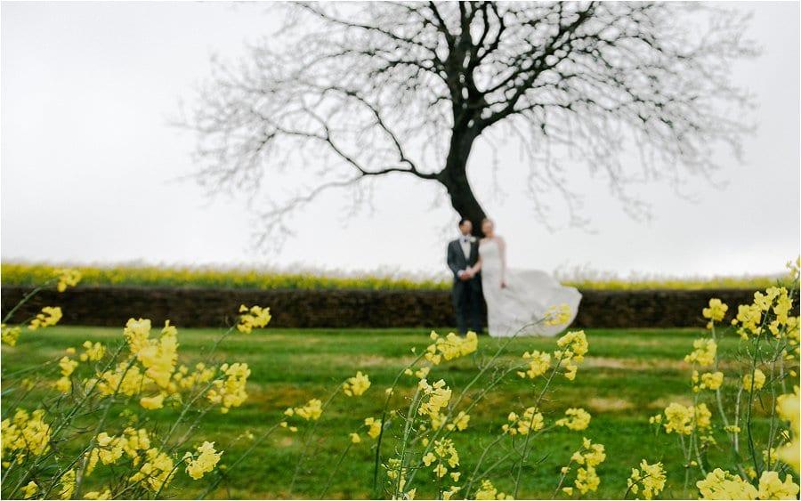 Kingscote Barn flowers in field photo