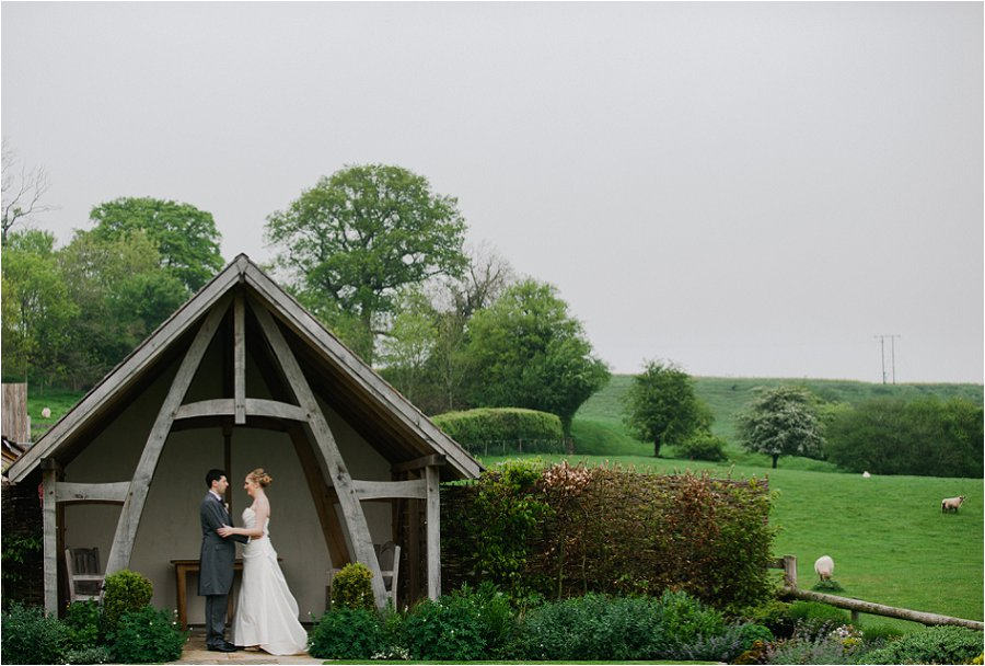 Kingscote Barn bride and groom under shelter