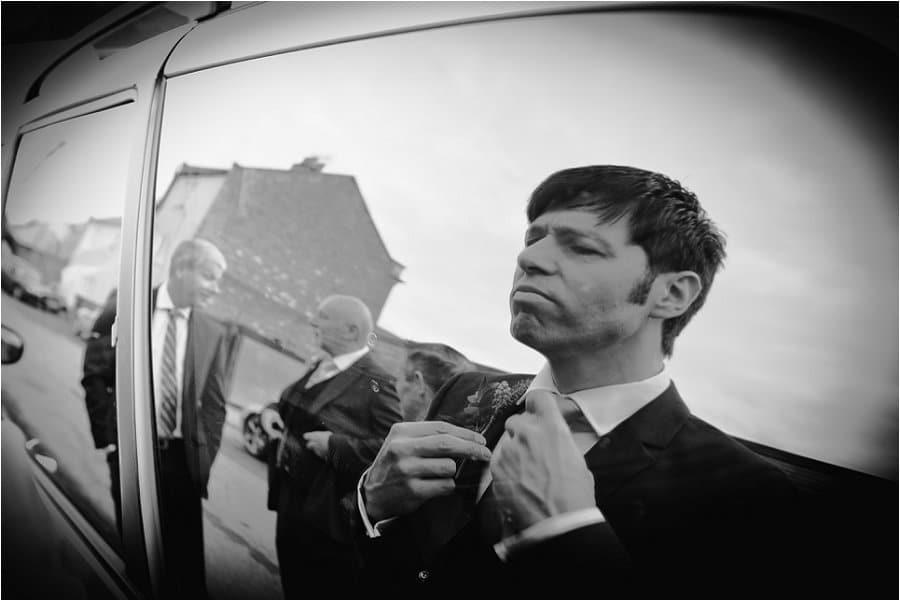 Wick Farm groom checking his reflection photo