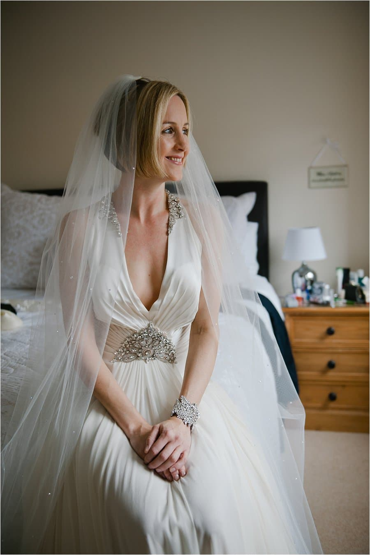 Wick Farm bride sat on bed photo