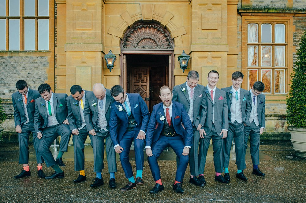 Eynsham Manor groomsmen showing off socks