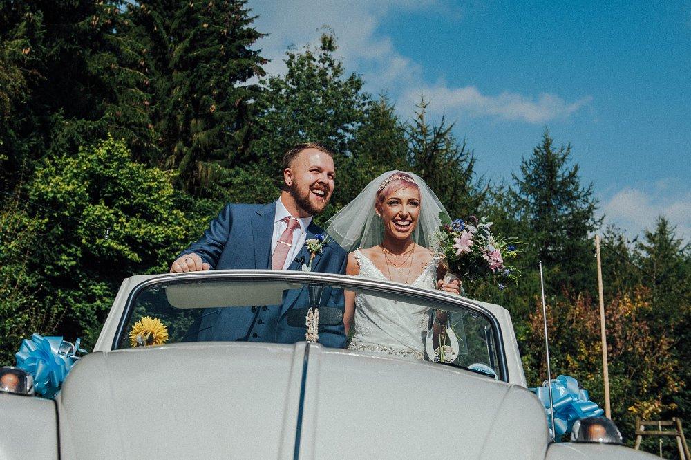 Wyldwoods wedding couple leave in car