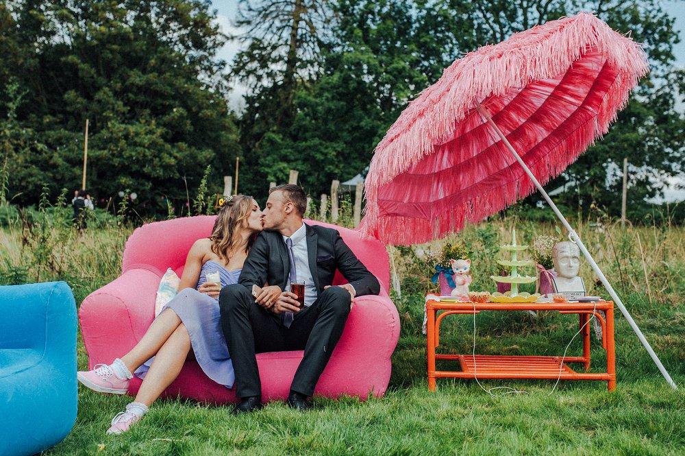 Wyldwoods couple kissing on sofa