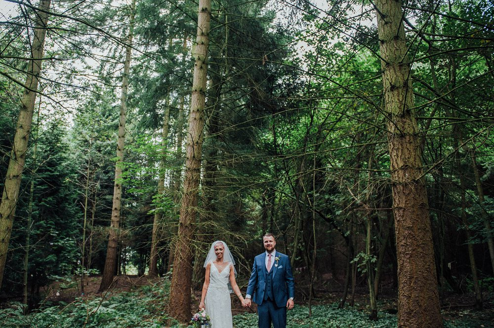 Wyldwoods couple holding hands in woods