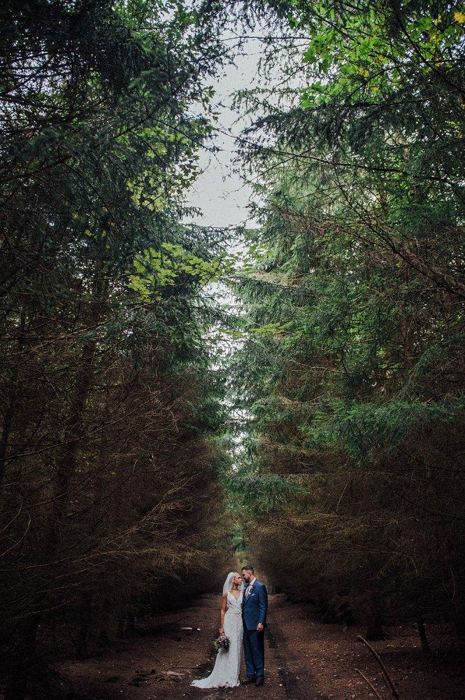 Wyldwoods couple posing in woods