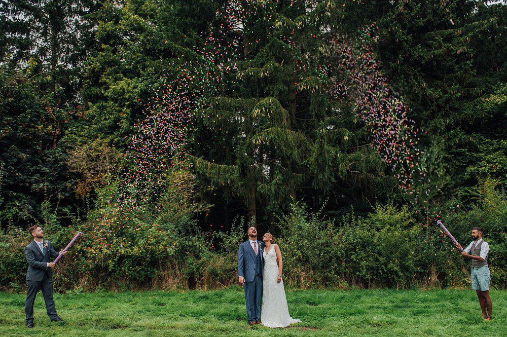 Wyldwoods wedding colourful confetti guns