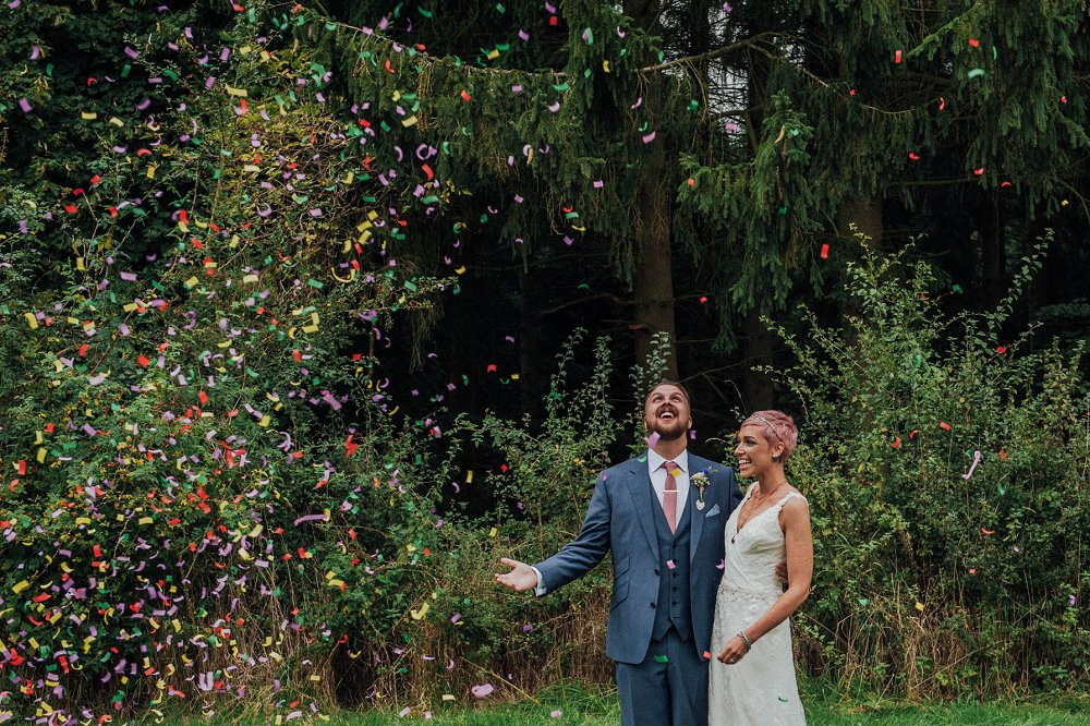 Wyldwoods bride and groom showered in confetti