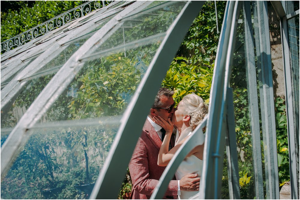 French Chateau Wedding kissing in the greenhouse