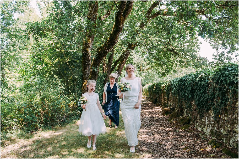 Logis Puygaty bride with bridesmaid walking photo