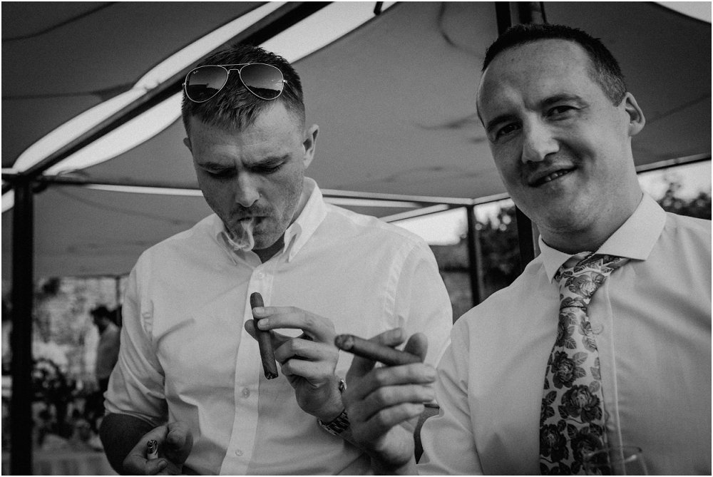 Logis Puygaty men with cigars photo