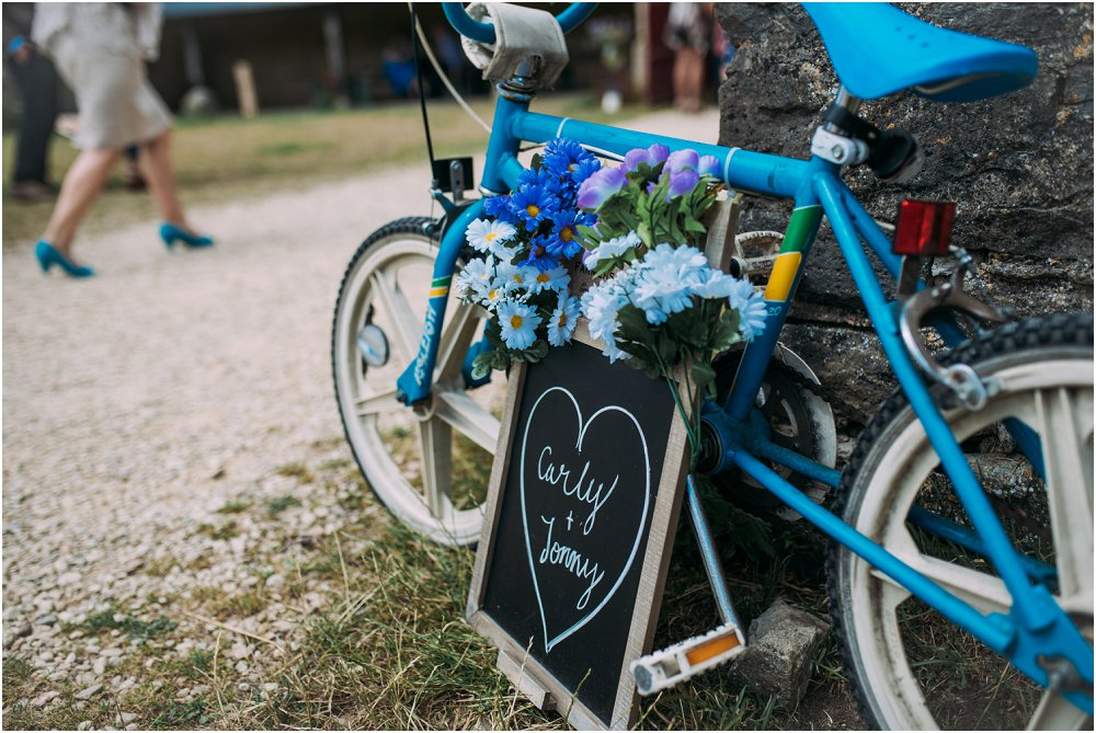 Cogges Manor Farm wedding sign on bicycle