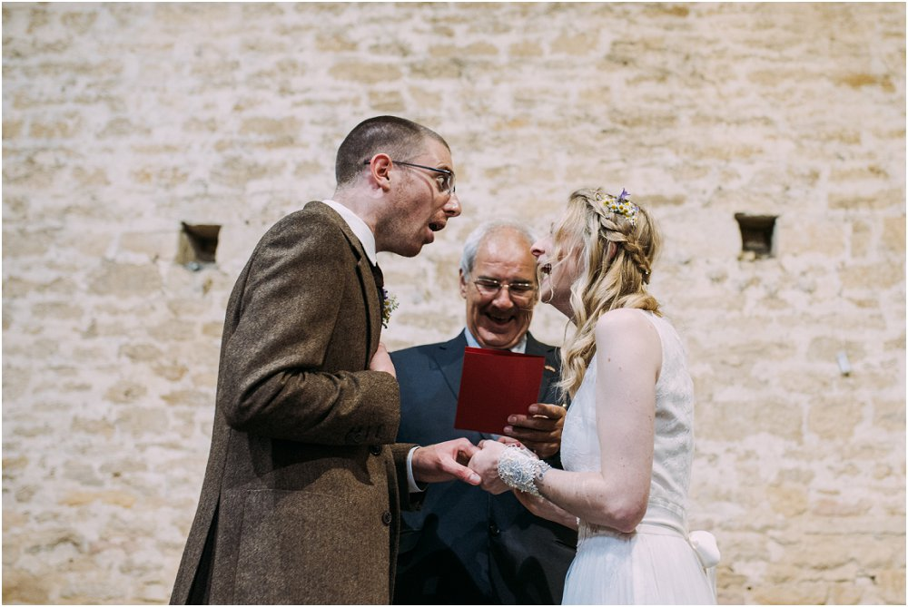 Groom looking shocked during Cogges Manor Farm ceremony