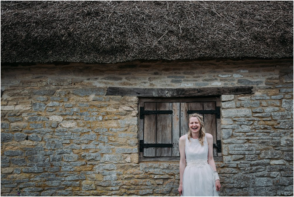 Cogges Manor Farm bride stood outside rustic barn