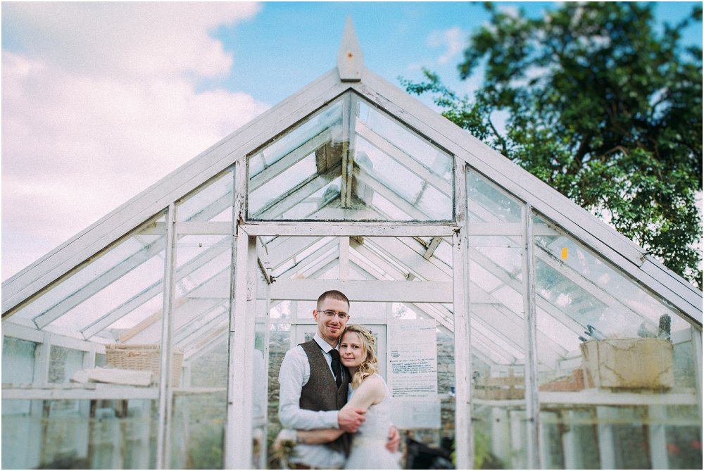 Cogges Manor Farm bride and groom in greenhouse