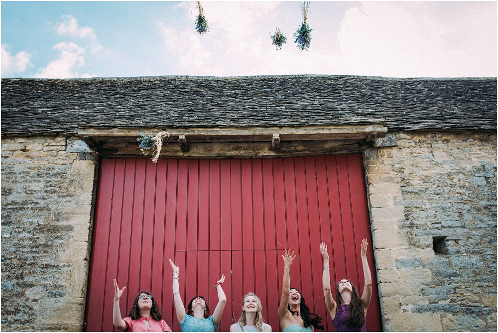 Cogges Manor Farm bridesmaids tossing flowers in air photo