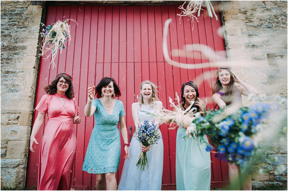 Cogges Manor Farm bridesmaids tossing flowers photo