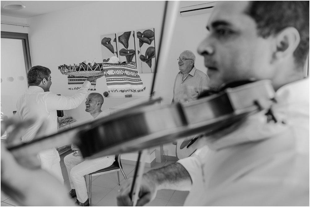 Anassa Hotel Cyprus groom being serenaded image
