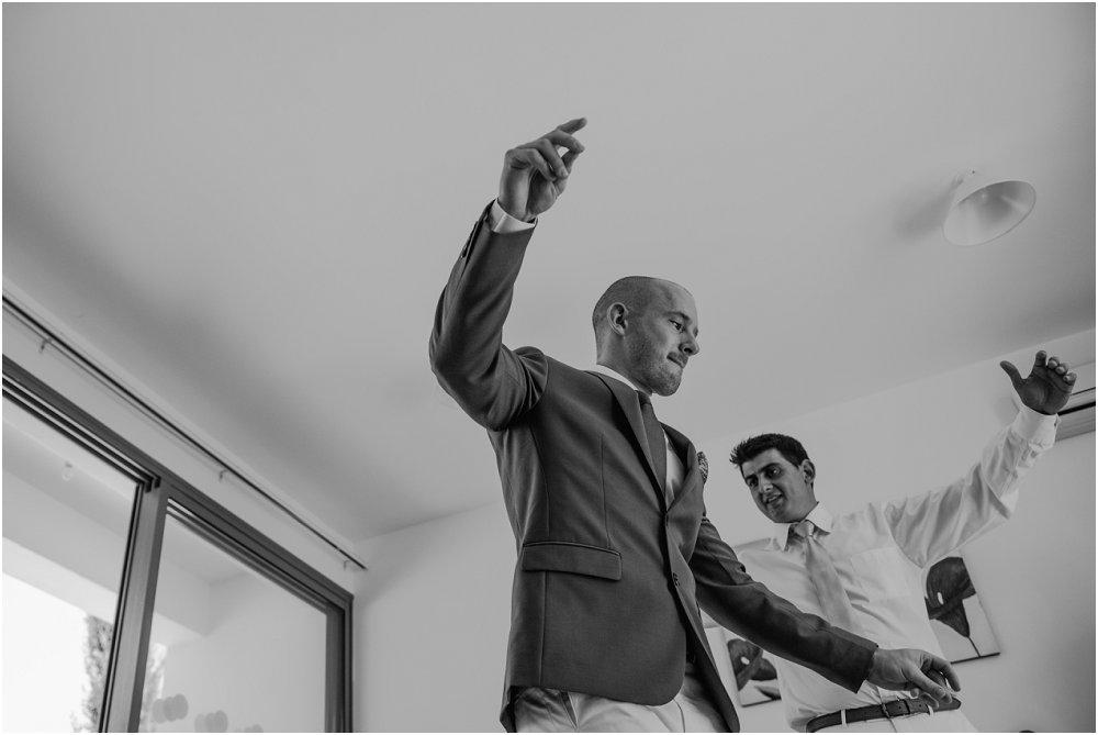 Anassa Hotel Cyprus groom dancing with bestman image
