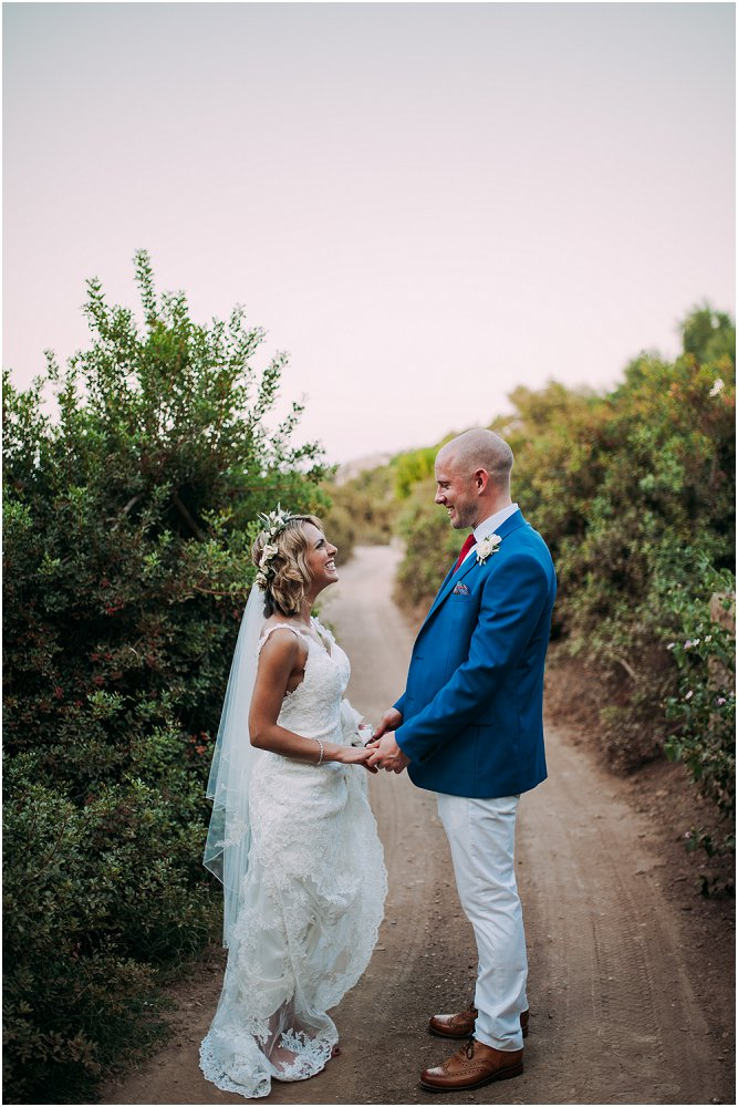 Anassa Hotel Cyprus bride in wedding dress with groom