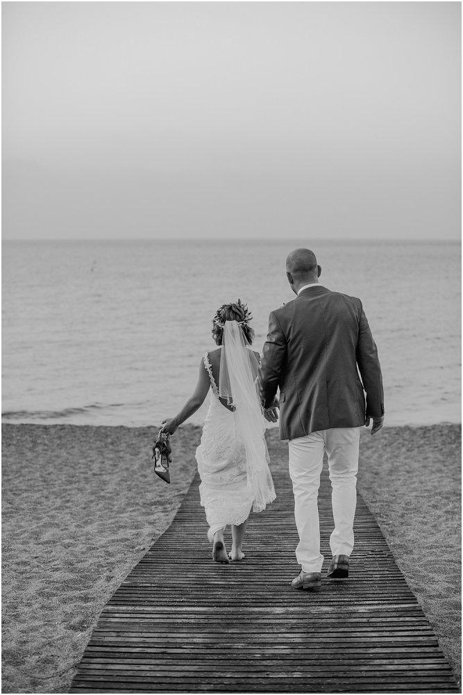 Anassa Hotel Cyprus bride and groom walking on beach