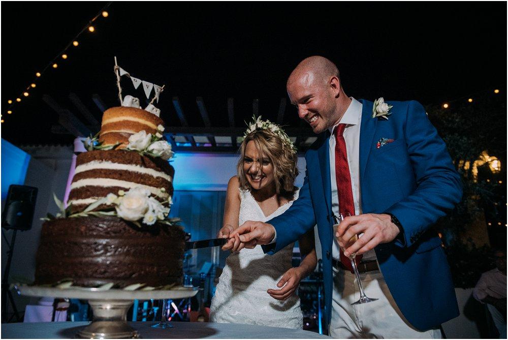 Anassa Hotel Cyprus cutting the wedding cake photo