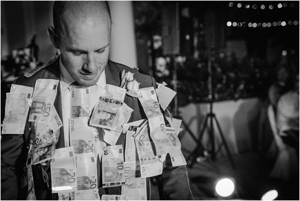 Anassa Hotel Cyprus tradition of Greek money on groom photo
