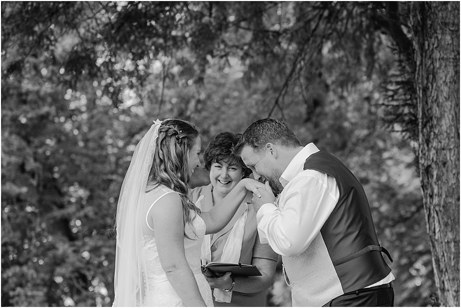 Chateau de Cazenac groom kissing hand wedding photo
