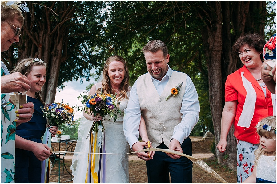 Chateau de Cazenac cutting ribbon wedding photo