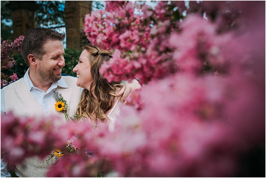 Chateau de Cazenac bride and groom with colourful flowers wedding photo