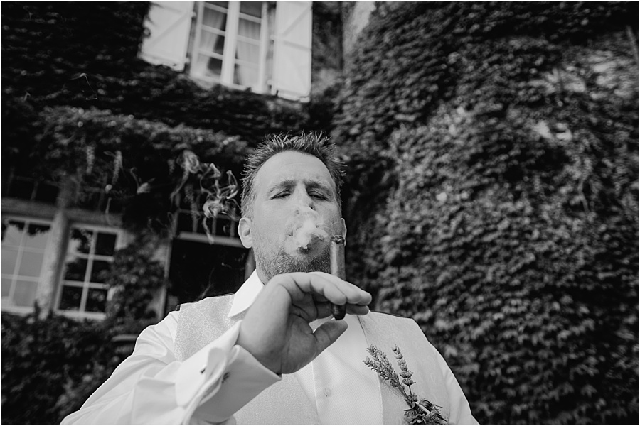 Chateau de Cazenac groom smoking cigar wedding photo
