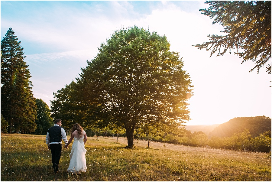 Chateau de Cazenac bride and groom walking at sunset wedding photo