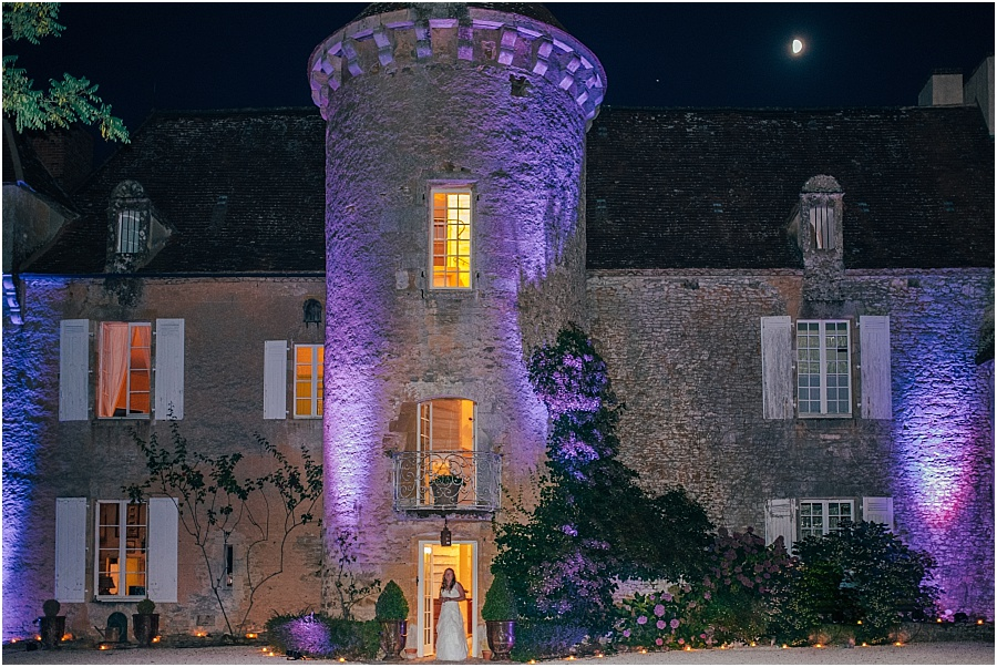 Chateau de Cazenac lit up with colours at night wedding photo