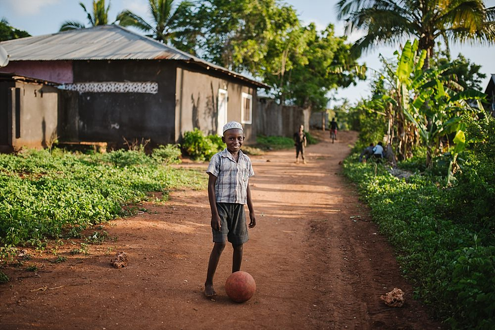 Personal photography Zanzibar village boy with ball