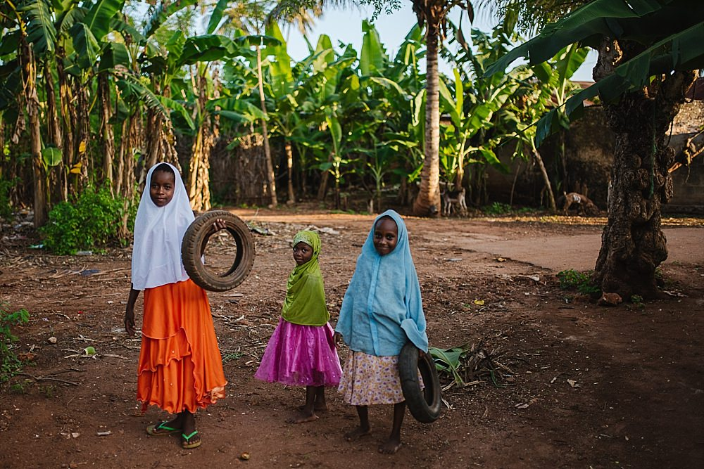 Personal photography blog Zanzibar village girls in colourful dresses