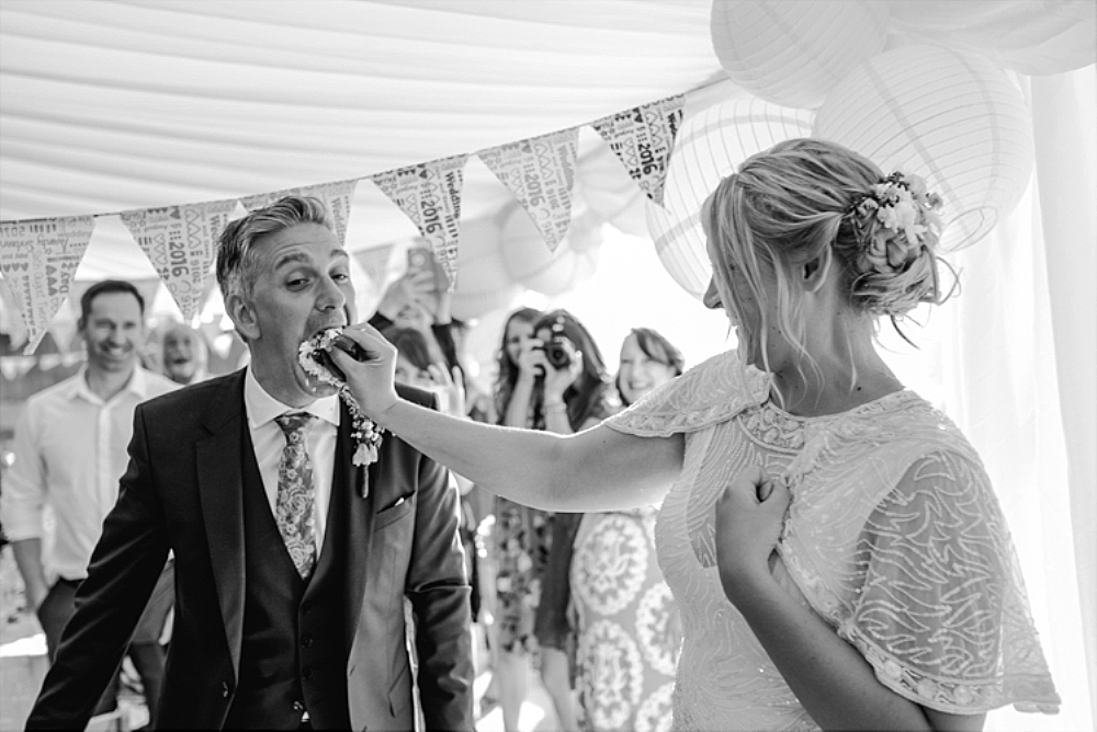 tetbury-wedding-photographer-holford-arms-cake-in-face