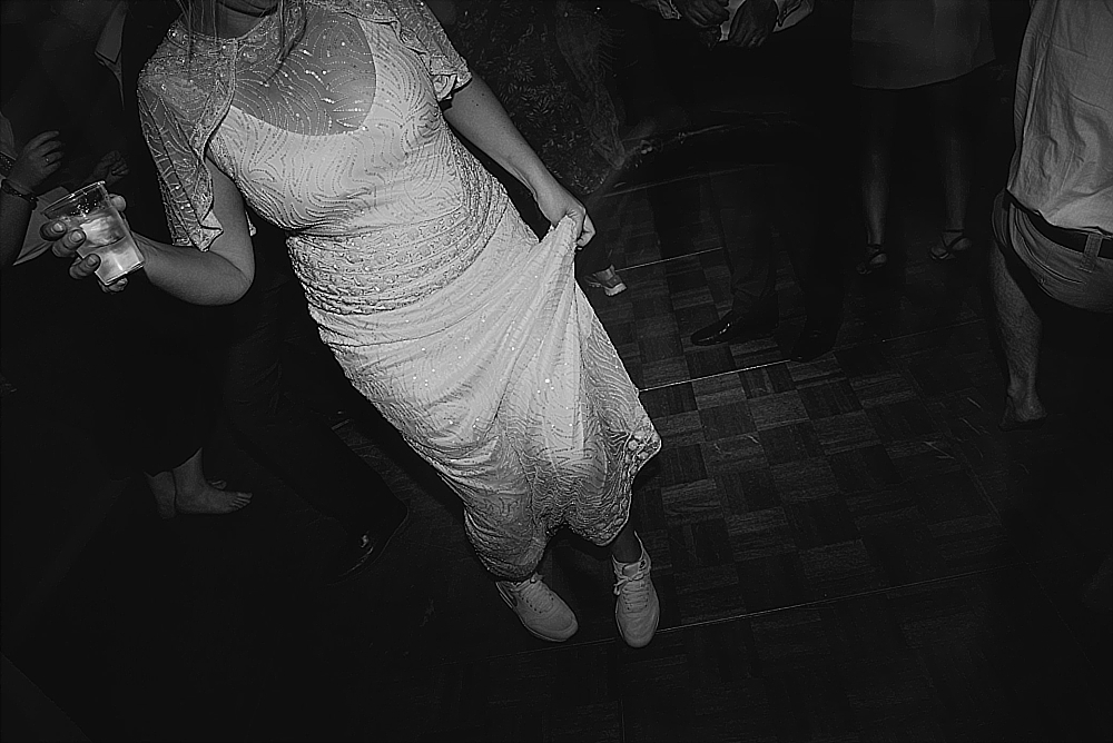 tetbury-wedding-photographer-holford-arms-bride-wearing-trainers