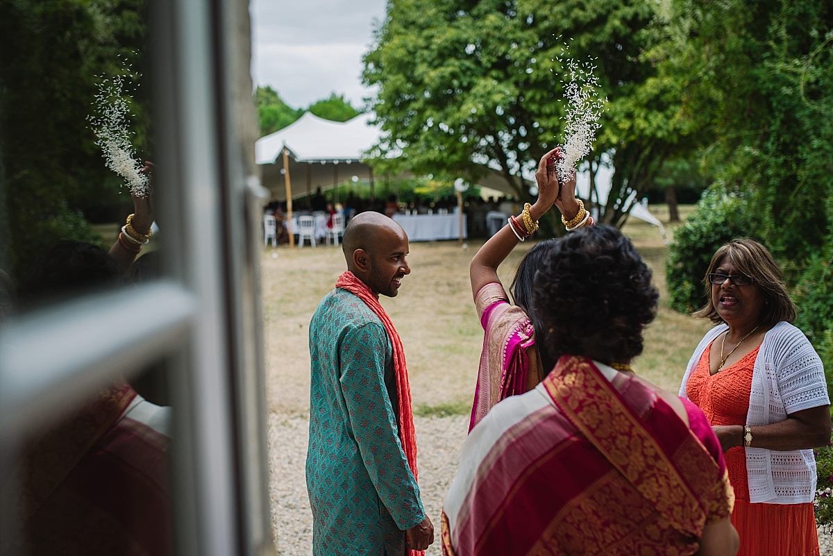 Indian Wedding Photography - throwing rice -Chateau De Malliac