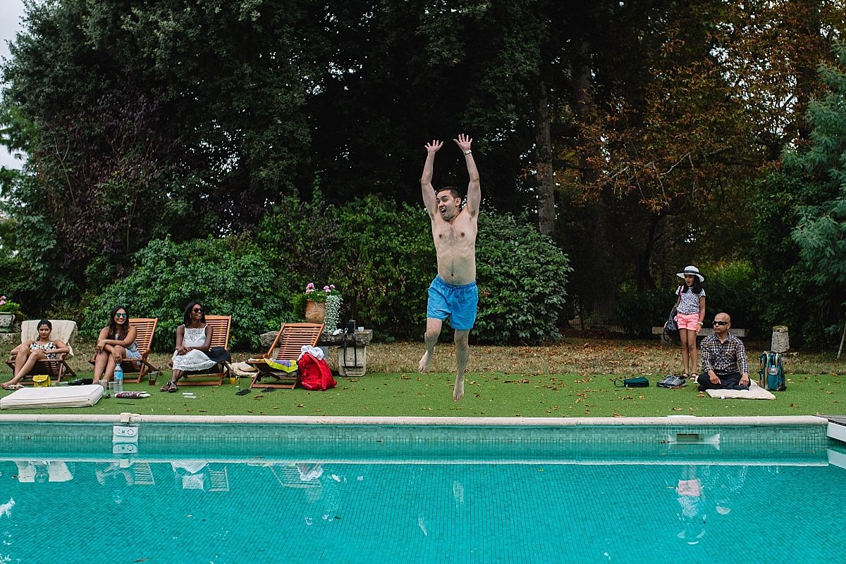 Indian Wedding Photography -a guest jumping into swimming pool-Chateau De Malliac