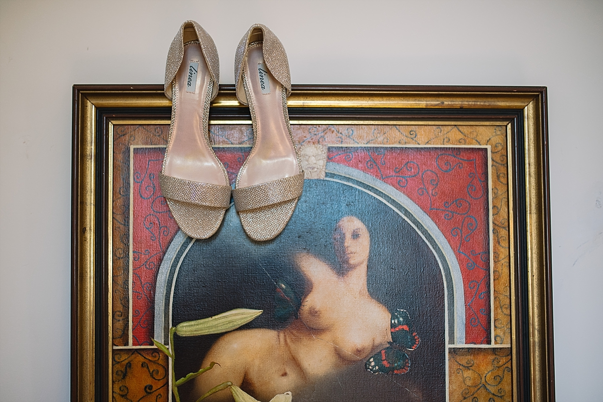 Indian Wedding Photography -wedding shoes hanging on art -Chateau De Malliac