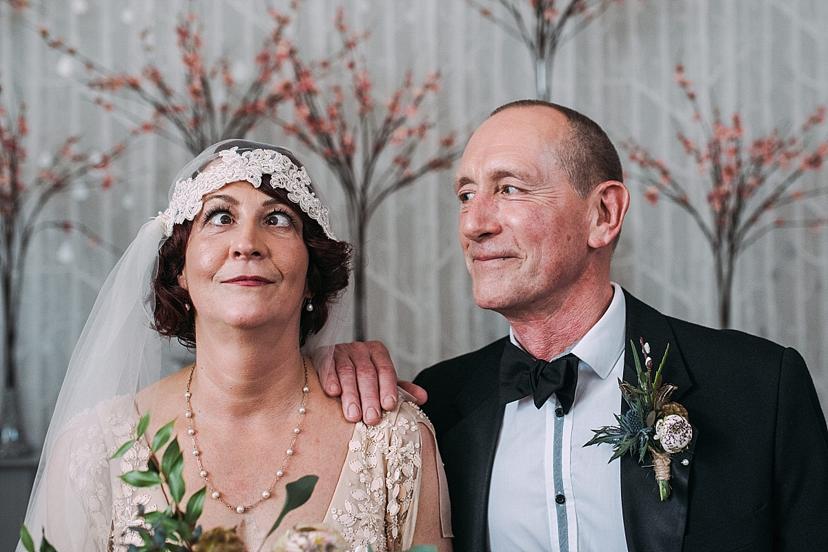Comedy portrait of cross-eyed bride and groom
