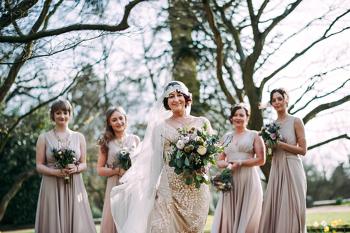 Bride wearing a 1920s vintage wedding dress holding bouquet styled by Ava Events