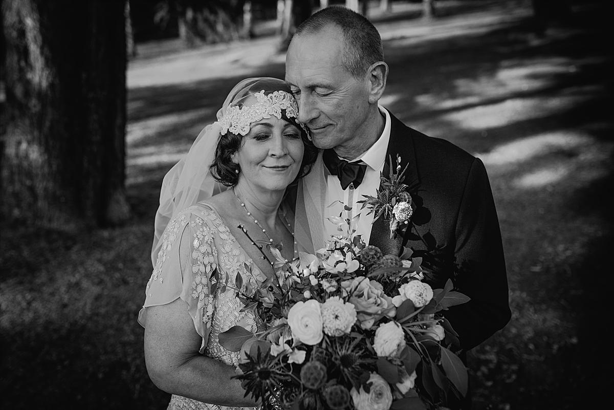1920's styled bride in Eliza Jane Howell column wedding dress