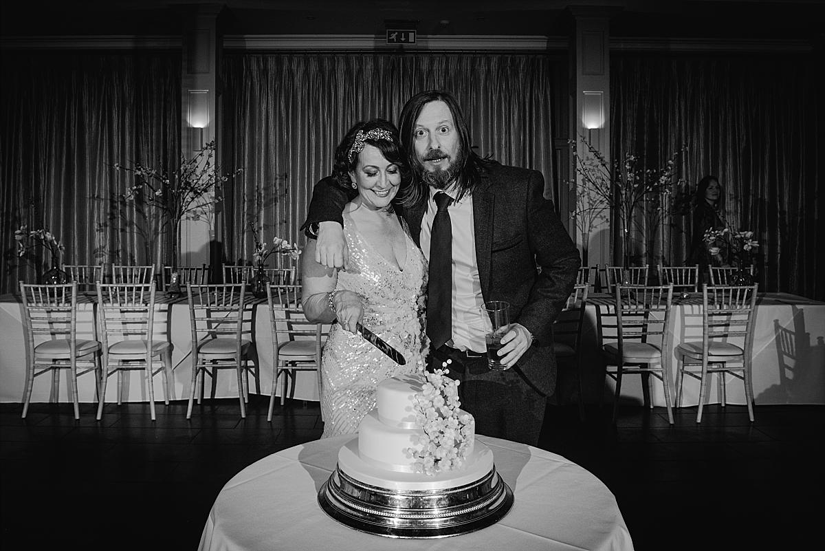 Cutting the cake Hampton Manor Wedding Photography