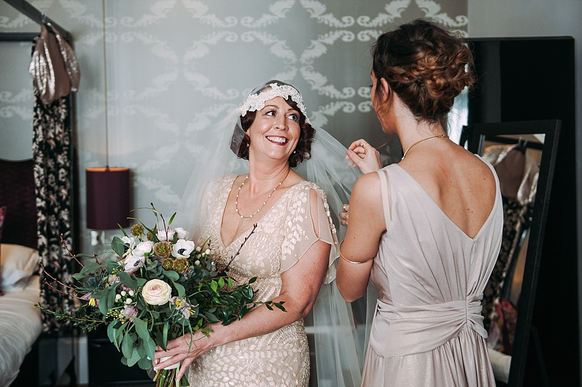 Vintage Jazz Age styled bride holding bouquet