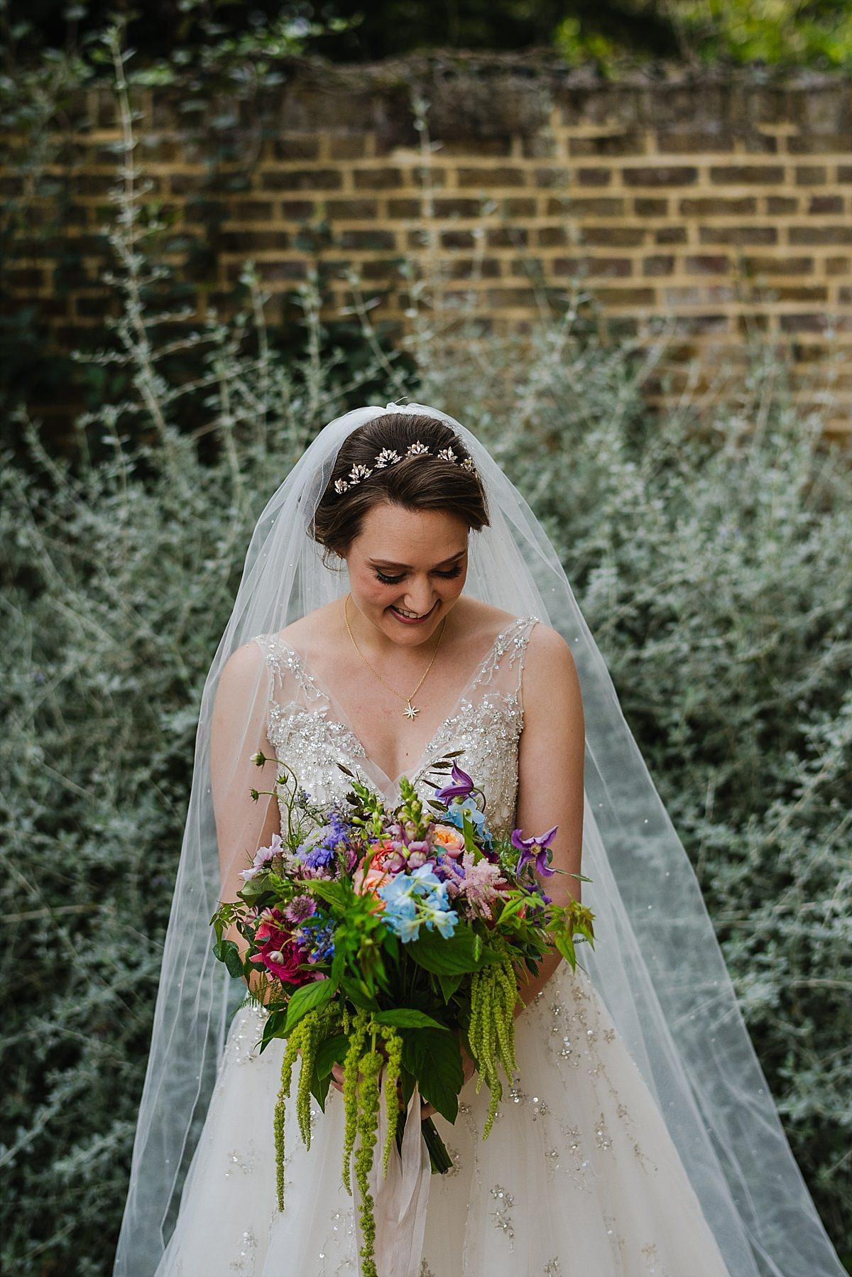 Bride with bouquet at Dorney Court