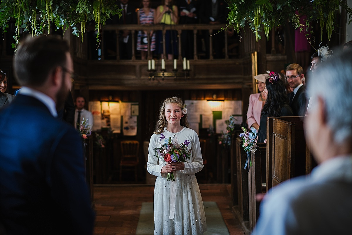 Bridesmaid with bouquet at Dorney Court chapel