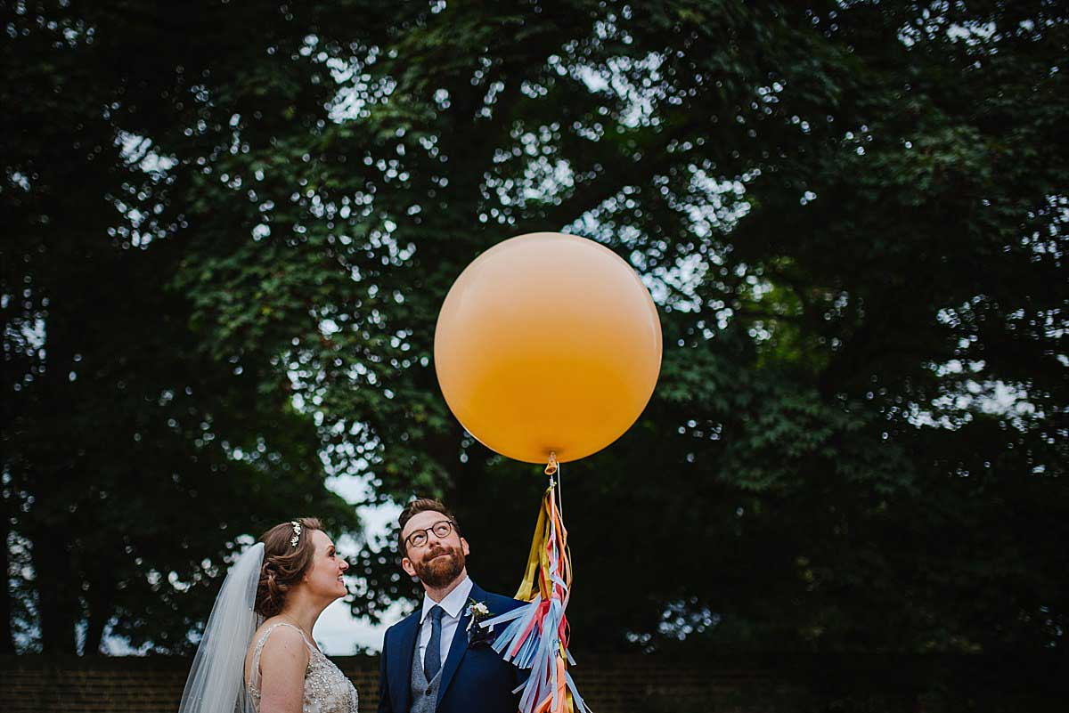 Wedding photographer Gloucestershire couple with balloon