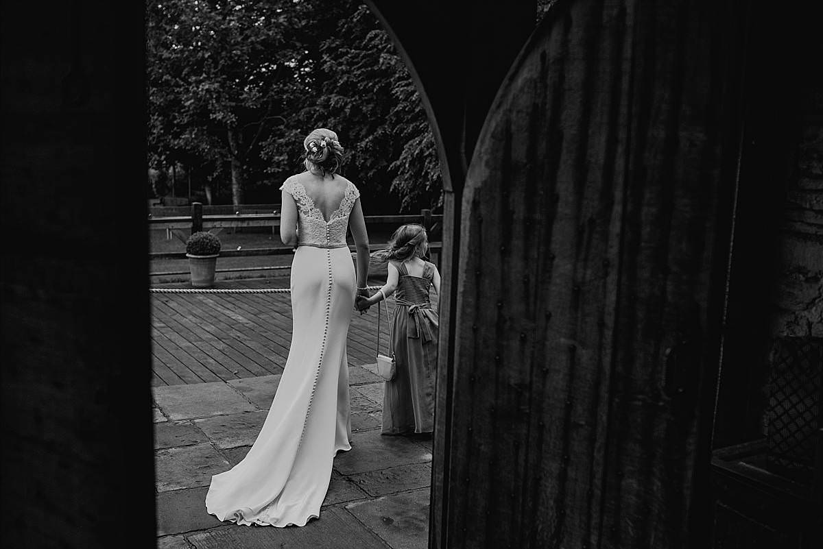 full length view of back of the brides and bridesmaids wedding dress